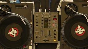 Two spinning turntables platters, nightclub DJ equipment working