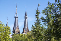 Two spires in the sunlight in Amsterdam Royalty Free Stock Photos