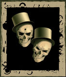 Two spiteful skulls. In a framework Royalty Free Stock Photos