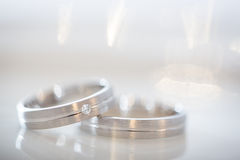 Two splendid wedding rings on a wedding day Stock Photos