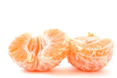 Two split halves of a peeled tangerine on white Royalty Free Stock Photos
