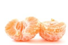 Two split halves of a peeled tangerine on white Royalty Free Stock Photos