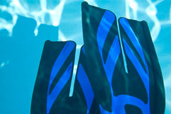 Two split swim fins underwater Royalty Free Stock Photos