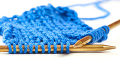 Two spokes with knit blue woolen cloth isolated macro Royalty Free Stock Photos