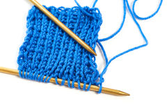 Two spokes with knit blue woolen cloth isolated macro Royalty Free Stock Images