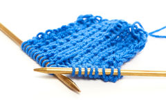 Two spokes with knit blue woolen cloth isolated macro Royalty Free Stock Photography
