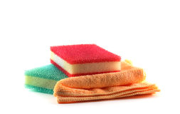 Two sponges and cleaning cloth. Red and green sponges and cleaning orange cloth Royalty Free Stock Images