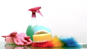 Two sponges are falling on the table. Against white background stock footage