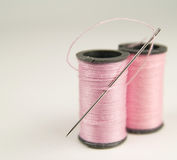 Two Spools of Pink Thread with Needle stock photography
