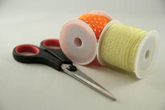 Two spools with scissors Royalty Free Stock Photos