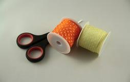 Two spools with scissors Stock Photo