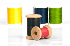Two spools of thread. On the background of the coils Stock Images