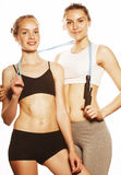 Two sport girls measuring themselves isolated on white Stock Images