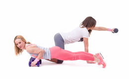 Two sport woman exercise with dumbbells Royalty Free Stock Image