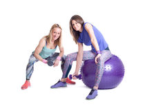 Two sport woman exercise with a pilates ball and dumbbells Stock Images