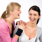 Two sport woman friends smiling. Two women friends sport outfit smiling isolated portrait Royalty Free Stock Photo