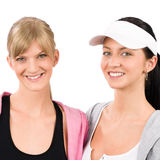 Two sport woman friends smiling. Two women friends sport outfit smiling isolated portrait Stock Images