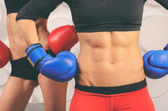 Two sporting women with beautiful abdominal muscles Royalty Free Stock Photography