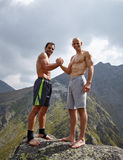 Two sportive men shaking hands Stock Photography