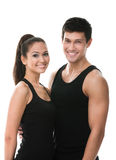 Two sportive people in black sportswear embrace Stock Photography