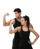 Two sportive people showing the biceps Royalty Free Stock Photos