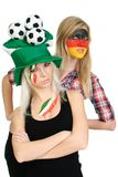 Two sports fans with painted faces Stock Photos