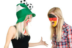 Two sports fans with painted faces Royalty Free Stock Images