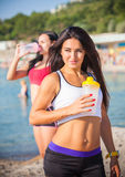 Two sports girls on a beach Stock Photography