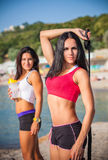 Two sports girls on a beach Stock Images