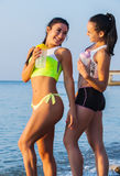 Two sports girls on a beach Royalty Free Stock Image