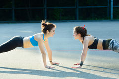 Two sports girls engaged in gymnastics Stock Photography