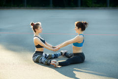 Two sports girls engaged in gymnastics Stock Images