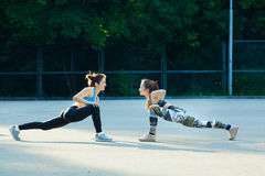 Two sports girls engaged in gymnastics Royalty Free Stock Image