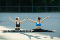 Two sports girls engaged in gymnastics Royalty Free Stock Photography