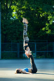Two sports girls engaged in gymnastics Royalty Free Stock Images