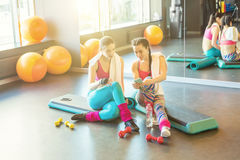 Two sports woman friends chatting after workout. royalty free stock images
