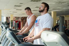 Two sportsmen in gym. Royalty Free Stock Photo