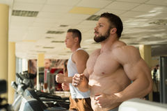 Two sportsmen in gym. Royalty Free Stock Photos