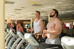 Two sportsmen in gym. Stock Photos