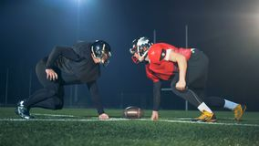 American football players on a special field, side view. stock video footage