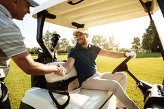 Two sportsmen shaking hands Stock Photography