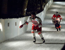 Two sportsmen skate downhill Royalty Free Stock Image
