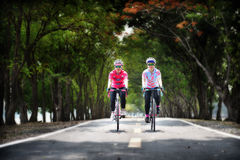 Two sportswoman ride bike at park Royalty Free Stock Images