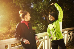 Two sportswomen stretching. While standing on bridge Stock Photo