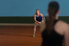 Two Sporty Female Tennis Players Enjoying A Game Stock Images