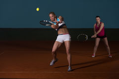 Two Sporty Female Tennis Players Enjoying A Game royalty free stock photo