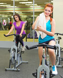 Two sporty girls at fitness club Stock Photography