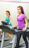 Two sporty girls at fitness club Stock Images