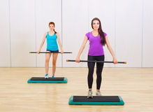 Two sporty girls at fitness club Royalty Free Stock Images