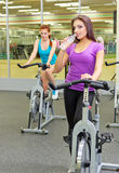 Two sporty girls at fitness club Royalty Free Stock Image